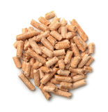 Wooden pellets. Top view of wooden pellets isolated on white Stock Photos
