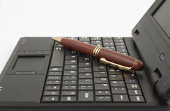 The wooden pen on notebook keyboard. The wooden pen on the black keyboard of notebook Stock Photo