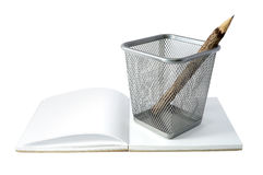 Wooden pencil in basket with book Royalty Free Stock Images