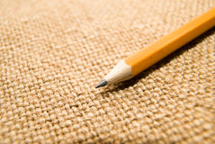 Wooden pencil drawing on an old cloth Stock Photography