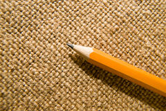 Wooden pencil drawing on an old cloth Royalty Free Stock Image