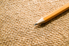 Wooden pencil drawing on an old cloth Royalty Free Stock Photos