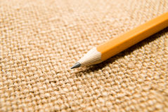 Wooden pencil drawing on an old cloth Stock Photo