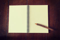 Wooden pencil on notebook Stock Images
