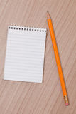 Wooden pencil and notepad Stock Images