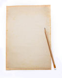 Wooden pencil on the old dirt crumpled paper Stock Photos