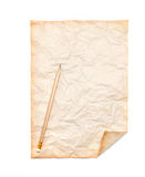 Wooden pencil on the old dirt crumpled paper Royalty Free Stock Photos