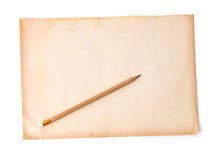 Wooden pencil on the old dirt paper Stock Photo