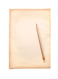 Wooden pencil on the old dirt paper Royalty Free Stock Images