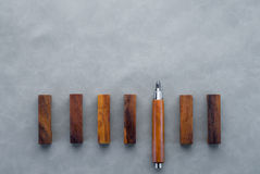 The wooden pencil with one different as a symbol.jpg Stock Photography