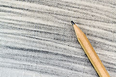 Wooden pencil. Roughly drawn textured background with a pencil Royalty Free Stock Photography