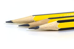 Wooden pencil on a white background Royalty Free Stock Images