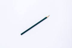 Wooden pencil on white background. Stock Image