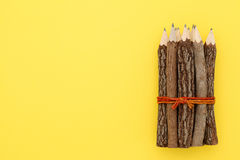 Wooden pencils. On yellow paper background Stock Photography