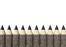 Wooden pencils with tree trunk, background Royalty Free Stock Photo
