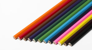 Wooden pencils of various colors on white background. Stock Photos