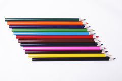 Wooden pencils of various colors on white background. Stock Image