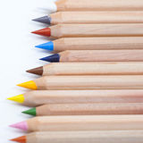Wooden pencils on the white background. Colour pencils on the white background Royalty Free Stock Photography