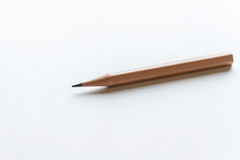 Wooden Pencils on white paper. With copy space Royalty Free Stock Photo