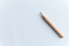 Wooden Pencils on white paper. With copy space Stock Image