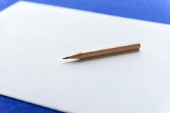 Wooden Pencils on white paper. With copy space Royalty Free Stock Photos