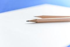 Wooden Pencils on white paper. With copy space Royalty Free Stock Photography
