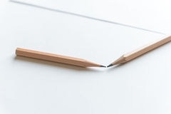 Wooden Pencils on white paper. With copy space Stock Photo