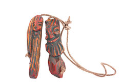 Wooden pendant amulet in the form of an inseparable pair of men Royalty Free Stock Photography