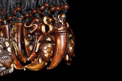 Wooden pendant in the shape of  tusk Royalty Free Stock Photography