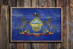 Wooden Pennsylvania flag. 3d rendering of a Pennsylvania State USA flag on a wooden frame and a wood wall Stock Photography