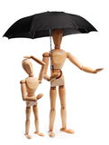 Wooden people under an umbrella Stock Photos