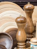 Wooden pepper mills and wooden plates Royalty Free Stock Photos