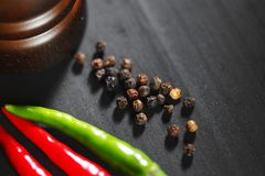 Wooden peppermill with pepper Stock Photography