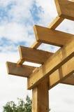 Wooden pergola against blue sky Royalty Free Stock Photos