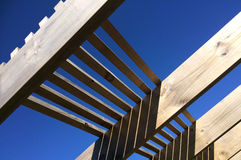 Wooden pergola against blue sky. Of garden feature forming a shaded walkway, passageway or sitting area Royalty Free Stock Image