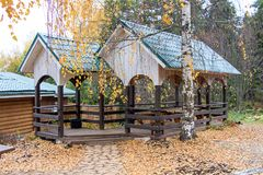 Wooden pergola during an autumn. Photo of wooden pergola during an autumn Stock Image