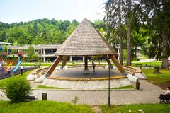 Wooden pergola on the kids playground in beautiful park in the balneary resort with mineral thermal water Baile Olanesti. Romania. Valcea County, Baile stock image