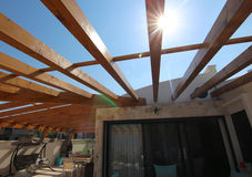 Wooden pergola on the roof of a villa Stock Photos