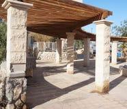 Wooden pergola. With stone columns Royalty Free Stock Photo