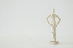 Wooden person standing with his back looking at empty white space concept Stock Images