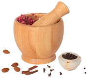 Wooden pestle and mortar with some spices on white. Background. Isolated. Light shadow Royalty Free Stock Photography