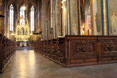 Wooden pew in the cathedral Stock Photography
