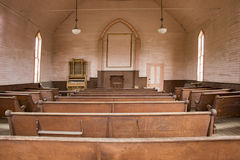 Wooden pews inside rustic wooden church stock photos
