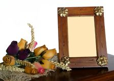 Wooden Photo Frame. Flowers and cereal spikes on white background Royalty Free Stock Photo