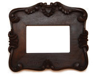 Wooden photo frame. Massive wooden photo frame isolated on white Stock Images