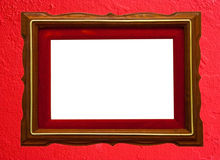 Wooden photo frame. On red wall  background Stock Photo