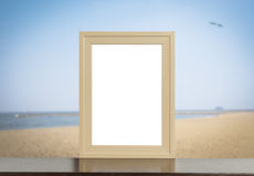 Wooden photo frame with beach background. Royalty Free Stock Photos