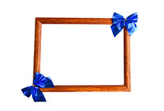 Wooden photo frame and blue bows Stock Photo