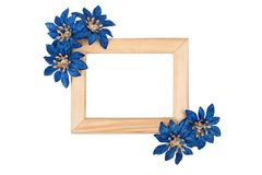 Wooden photo frame with blue flowers Stock Photography