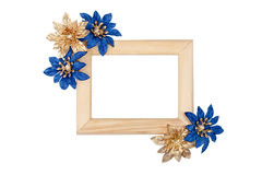 Wooden photo frame with blue and golden flowers Stock Photo